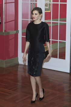 Queen Letizia of Spain Embellished Top - Queen Letizia of Spain looked simply elegant at the Expansion newspaper 30th anniversary event wearing a black Carolina Herrera top with beaded and feathered sleeves.