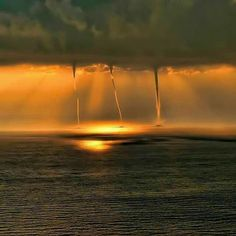 Three Water Spouts. Photograph by Pete Dooley