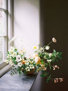 The touches of yellow in a white floral arrangement make this a standout arrangement!