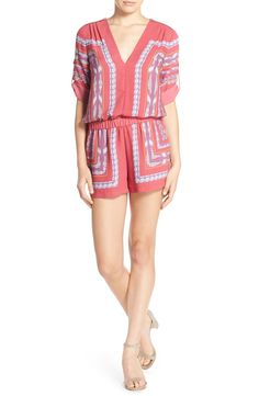 Tapestry scarf prints cover this adorable romper from BCBGMAXAZRIA. It's classically tailored with roll-tab sleeves and a comfy elastic waist.