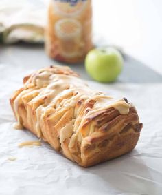 Caramel apple pull apart bread made with sweet apples, a tender cinnamon spiced dough and a silky caramel glaze! lemonsforlulu.com #CreateDelight #IDelight