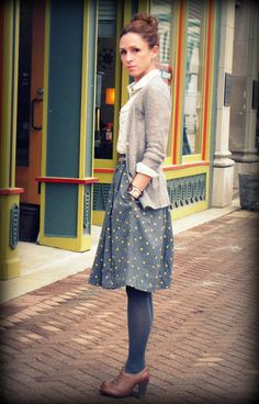 Mixing the lace and polka dots with different textures from the tights, sweater, and skirt! Lovee it