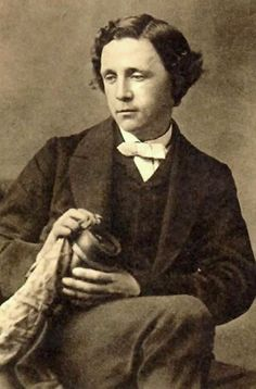 Lewis Carroll's real name: Charles Lutwidge Dodgson. Ths pseyudonym comes from variations on his name derived from Latin. Lewis is an anglicaized verson Lutwidge and Carroll is an Irish surname similar to the Latin for Charles.