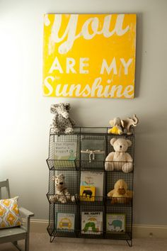 A wire bookshelf is a stylish way to corral some stuffed animals and books (from Chic.Home.Baby).