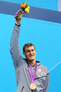 Peter Vanderkaay celebrates with his bronze medal during the medal ceremony for the men's 400m freestyle on Day One of the 2012 London Olympics.