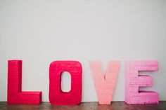 Today we are sharing how to make those giant fringe LOVE letters you saw from our GWS booth from The Cream Event! These letters would make a super fun ceremony backdrop, or reception decor piece! You could even spell out your new last name, nicknames or other sweet words! Love all the possibilities! One thing...