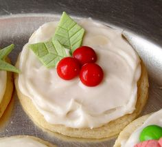 Candy Decorated Christmas Sugar Cookies (Looks like the leaves are made from sticks of wintergreen gum!)