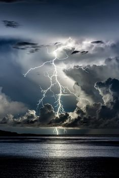 Lightning via Forward, clouds, thunder storm, Ocean view, water, reflections, light beams, beauty of Nature, wild, stunning, amazing, beautiful, photo