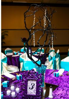 purple and turquoise wedding tablescape- created the manzanita centerpieces with crystals and turquoise rocks in vases.