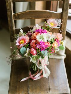mixed spring bouquet, photo by Lauren Fair Photography http://ruffledblog.com/stonebrook-farms-bohemian-wedding #flowers #weddingbouquet