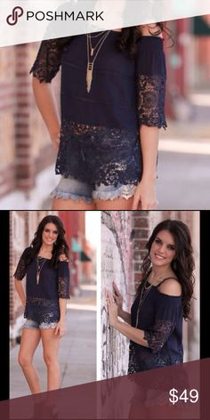 """Navy Lace Cold Shoulder This top is a must have! Lace detail, adjustable shoulder straps. Wearable now to transition into Spring. Lightweight enough for summer! Self-100%Rayon Contrast-100% Polyester Bust (S) 16"""" (M) 17"""" Length (S) 26"""" (M) 27"""" Boutique  Tops"""