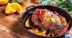 Roasted meat with orange slices in pan for Christmas dinner and festive decoration on dark rustic background, top view Rustic Background, Roasted Meat, Orange Slices, Christmas Cooking, Festival Decorations, Paella, Steak, Pork, Cooking Recipes