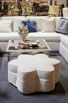 White sectional couch with flower ottoman | perfect for coastal living or to lighten up a darker room | Found at Avery Lane Fine Consignment in Scottsdale, AZ