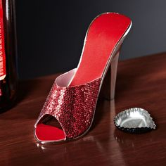 Set a trend of your own with a dazzling red high heel bottle opener. Made of solid metal with a glossy chrome finish our wine cooler and beer bottle opener makes it easy to crack open a bottle with. Red Bottom Shoes, Beer Bottle Opener, Red High Heels, Wine Stoppers, Best Beer, Red Bottoms, Cool Walls, Heeled Mules, Peep Toe