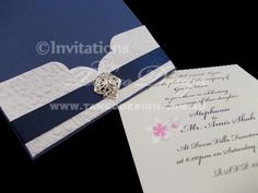 Paris pocket wedding invitation with embossed pocket, blue satin ribbon and crystal brooch. Created by www.tangodesign.com.au