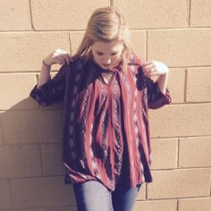 """Marsala top w/ bell sleeves  SOLD This is a very sweet and colorful top. It is loose fitting, and has little pockets in the sides. This top is very noticeable & would look great paired with some skinnies and boots. It is an overall great top for an everyday look. It is made of a polyester blend and is available in a size L. The total length of the top is 32"""", the bust is 42"""" & the length of the sleeves from armpit down are 16"""". Boutique  Tops Blouses"""