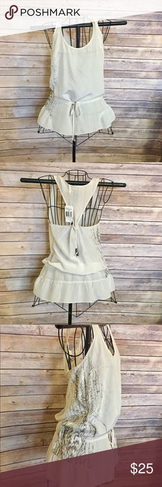 🆕(NWT) GUESS top 🆕 (NWT) beautiful GUESS top , light taupe color , zips on one side & print in other, cinched  at waist with beaded drawstring , x small size , but definitely could fit a small as well Guess Tops