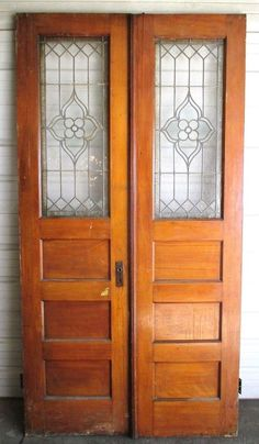 I would LOVE this pocket door compromise: rustic wood with a stained glass window insert!