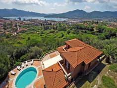 Luxury real estate in Portoferraio Italy - Inviting villa with pool and panoramic views - JamesEdition