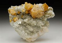 Well formed crystals of Scheelite from the Pingwu Beryl Mine, Sichuan Province, China. Crystal Classics Minerals