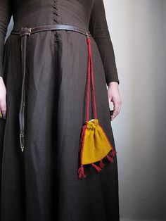 This type of textile bag with tassels can be found in manuscripts and pictures from the middle of the 13th century to the middle of the 16th century. This is the type of bag that women wore hanging...