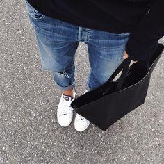 Bright blue denim, bright white shoes and black on black