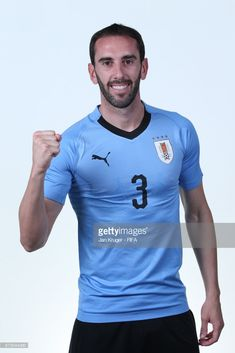 23e72c08d Diego Godin of Uruguay poses for a portrait during the official FIFA World  Cup 2018 portrait