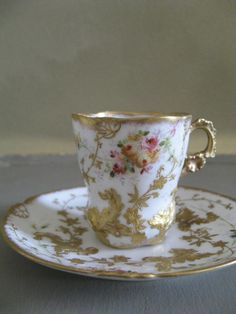 Estate 19th Century French Limoges Porcelain Incredible Hand Painted Cabinet Cup Saucer Antique French Limoges porcelain gold gilded and hand painted cup and saucer. The condition is very good with o