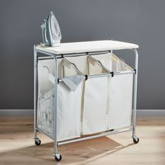 Triple Laundry Sorter with Ironing Board at Crate and Barrel Canada. Discover unique furniture and decor from across the globe to create a look you love. Laundry Sorter, Laundry Room Storage, Laundry Hamper, Laundry Bags, Laundry Rooms, Laundry Area, Laundry Drying, Laundry Closet, Mud Rooms