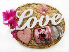A beautiful 'Love' shaped ornament, a heart shaped inspirational wall hanger and a scented soy candle in a glass jar with a lid make up this gorgeous Love Conquers All basket! Perfect for the ladies in your life!  Price: 19.99  http://luxuryhampers.ie/p/love_conquers_all_gift_basket