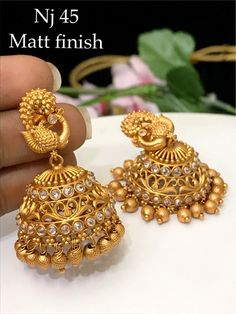 temple jewelry available at Arshi's. for bookings whatsapp on worldwide shipping. Gold Jhumka Earrings, Indian Jewelry Earrings, Jewelry Design Earrings, Gold Earrings Designs, Gold Jewellery Design, Gold Jewelry, Antique Jewellery Designs, Gold Ring Designs, Gold Buttalu