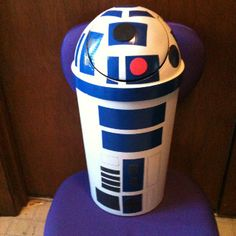 R2D2 trash can. Swing trash can black from Walmart. Spray painted white with Krylon plastic paint. Instead of painting details I used colored Duct Tape.