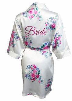 Wrap yourself in luxury in this gorgeous silky satin floral Bride robe with glitter print on the back. A perfect gift for the bride-to-be to wear on the morning of her wedding day! Features and Wedding Underwear, Wedding Lingerie, Bridesmaid Getting Ready, Bridal Party Robes, Bridesmaid Robes, Bridesmaids, Satin, Davids Bridal, Bride Gifts