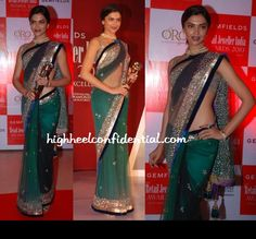 Bollywood Diva Deepika Paduoke looks stunning in shaded Green saree.  Credit: http://www.highheelconfidential.com/