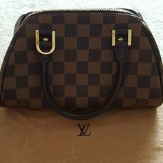 Louis Vuitton Rivera Damier 100% Authentic and very good condition. Includes dust bag. Serial: CA1023 Louis Vuitton Bags Mini Bags