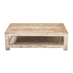 Brianna Coffee Table at Found Vintage Rentals. Rectangular wooden coffee table with chippy white paint.