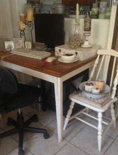 Needed a new computer desk for the kids lap top, found this old kitchen table & chair at a yard sale $10 :) works great & fits perfectly in with our country / shabby chic decor. Used some of the aromatherapy candles I make plus some vintage enamel ware, love it!