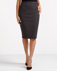 Any body type can pull of the sleek cut of this flattering Pencil Skirt. Designed with a slight stretch, it will accentuate your curves. Pair this skirt with high heels and a blazer inspired by menswear to add another dimension to your outfit.