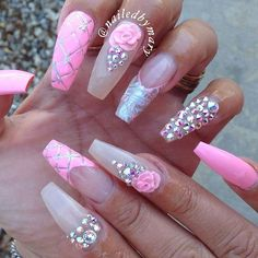 Pink and clear coffin nails with gemstones and roses. Too cute!