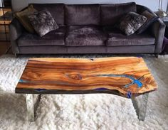 Modern Live Edge Coffee Table with glowing turquoise pigment and resin with silver, shiny legs THUNDERSTORM This crack going deep into the wood slab brought me an image of thunderstorm invading deep inside. Then it was frozen with resin and turquoise glowing pigment. Filled