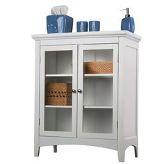 Add stylish storage to your home with this elegant white bathroom floor cabinet. The sturdy wood double cabinet is the perfect place to store your towels and toiletries, and the clean white design adapts to work with almost any decor.