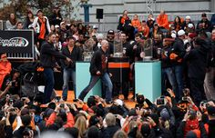 San Francisco Giants' Hunter Pence, left, and Tim Hudson, right, fire up the crowd as they celebrate their World Series championship at Civic Center Plaza in San Francisco, Calif., on Friday, October 31, 2014.  (Jane Tyska/Bay Area News Group)