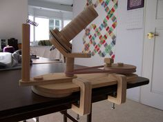 Yarn baller or winder. The plans for the baller, a yarn swift and a table-top yarn spinner are available for about $30