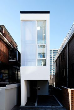 Continuing the trend for slender houses on constricted city sites, Guro-dong Mini House slots into the narrow space between two existing buildings in Seoul's Guro District to provide a shared home for three individual occupants.