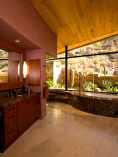 Janet Brooks Design | Scottsdale, AZ | Luxury Interior Design  Now this is an awesome bathroom!! Love the organic shape of the tub area and the openness of the space.  The use of the glass wall is so important to this space because it gives one the feeling of being apart of the beautiful Scottsdale desert. Love the color palette which speaks to the desert colors outside.