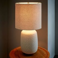 "$169.00  Dimensions: 14""diam. x 24""h. Pierced Ceramic Table Lamp 