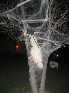 Hahaha, love it!! {Newspaper + cheese cloth + fishing line + artificial webbing + giant spider #halloween #decor #diy}