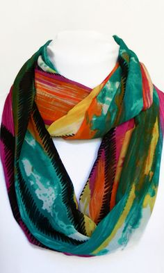 This colorful infinity scarf is the perfect accessory to add a splash of color to your outfit! Its lightweight chiffon fabric is soft and comfortable to wear.