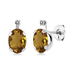 1.41 Ct Oval Champagne Quartz White Diamond 14K White Gold Earrings. This item is proudly custom made in the USA. 100% Satisfaction Guaranteed. Gemstones may have been treated to improve their appearance or durability and may require special care.