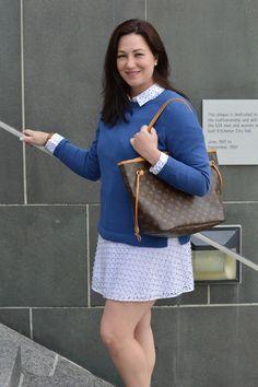 Blue sweater white skirt
